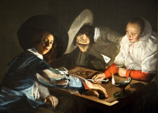 """Judith Leyster.  Dutch, 1609-1660.  """"One of the few women painters of Holland's golden age. Judith Leyster was remarkable for her time.   She was the only female member of the painters' guild known to have had a workshop, and the only woman painter whose attests to an active role in the art market. Two men and a woman have gathered around a tric-trac, or backgammon board.  The woman smilingly offers a pipe to her opponent.  The Dutch slang phrase """"to pipe"""" had a sexual connotation then as now.  As he reaches for his playing piece, the young man looks out as if to invite our involvement.   Leyster uses a single lamp and darkened background to concentrate on the relationship of the players.  There may be another game at play here;  the scene is perhaps a brothel.  The game of tric-trac stood for the dangers of idleness."""