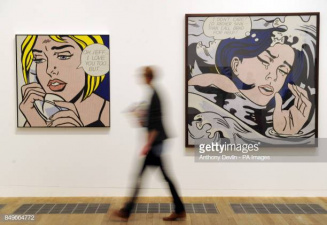 A woman passes Roy Lichtenstein's paintings Oh,Jeff...I Love You, Too...But... 1964, and Drowning Girl, 1963, during the press preview for Lichtenstein: A Retrospective at Tate Modern, London.   (Photo by Anthony Devlin/PA Images via Getty Images)